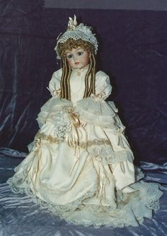 Porcelain Bride Doll repro done for a customer.  Painting by Kim, costume by Cookie.  'Dreams Unlimited.  :)