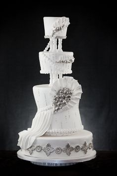 Three tiers of pure white wedding bliss with sugar paste fans and silver adornments make for an elegant contribution to the art of cake creations that go beyond the ordinary. Amazing Wedding Cakes, White Wedding Cakes, Elegant Wedding Cakes, Elegant Cakes, Amazing Cakes, Bling Cakes, Fancy Cakes, Gorgeous Cakes, Pretty Cakes
