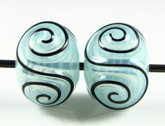 Kryptonite Blue and Black Scroll Hollow Glass Bead Pairs