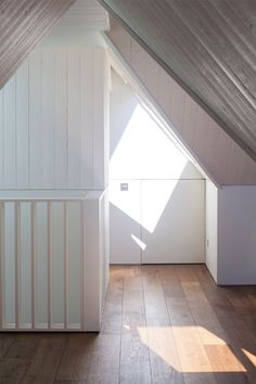 West Heath loft conversion with a secret room by Milford Martin Architects.