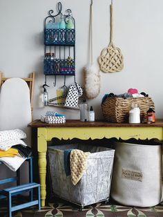 Swept Away. Lavender fills the room. The fluffiest, feathery-est dusters, lotions and sprays hang on the wall. Towels all neatly stacked, powders and big baskets. What is this wondrous place? The utility room.