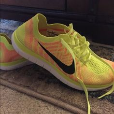 Neon Yellow Nike Flyknit Shoes Size 8.5 Neon yellow with orange detailing Nike Free 4.0 Flyknit Shoes Size 8.5. Briefly worn once but otherwise in perfect condition. Nike Shoes Athletic Shoes