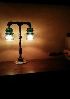 Steampunk Glass Insulator Lamp.  I wonder if Henry could make an extra tall one for lighting outside?