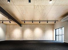 From concrete workshop to plywood-lined office Plywood Wall Paneling, Plywood Ceiling, Concrete Ceiling, Plank Ceiling, Ceiling Panels, Ceiling Beams, Ceilings, Plywood Interior, Interior Walls