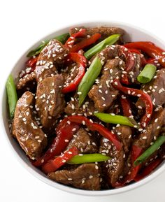 Super Easy Sesame Beef.Tender flank steak stir friedwith red peppers and green onions.Betterand healthier than takeout!