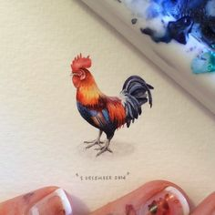 Tiny watercolor of a rooster.