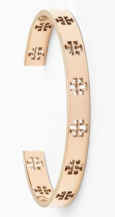 Signature Tory Burch T's are punched out along this slender rose gold cuff. Wearing it alone or stacking it with other bracelets will make for a sparkling modern look.
