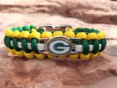 Green Bay Packers Paracord bracelet, proudly handmade by US Veterans. Green Bay Packers Paracord keychains also available. Meet the Veterans who make our products. Packers Baby, Go Packers, Nfl Green Bay, Green Bay Packers, Team Wear, A Team, Paracord Bracelets, Handmade Bracelets, Green And Gold