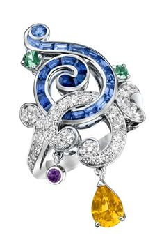 Van Cleef and Arpels stunning swirly ring with precious gems
