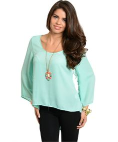 This lightweight woven top features a semi flared long sleeve with tassel trim. Hi-low hemline with slit back design. https://www.opensky.com/metamorphicfashion