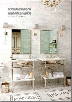 from COTE DE TEXAS -Betty Lou Phillips own guest bath has walls of Carrara subway tiles and small tiles of the same on the floor.  Whimsical bathmats were created out of tile