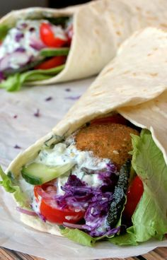 Falafel Wrap with Tzatziki Sauce (a chick pea meatball in a greek yogurt and cucumber sauce).  A great vegetarian meal.  A restaurant near me serves these with stuffed grape leafs, hummus, or a rice blend.