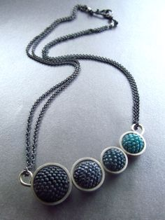 Circles Necklace by Lisa Gastelum:  My beaded rounds encircled by my handmade sterling rings.