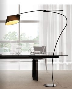 Contemporary desk with beautiful lamp. How to make a very modern office feel a bit more cosy.