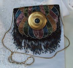 Beaded Peacock Purse, Dramatic Haute Couture, vintage compact mirror on front, via Etsy.