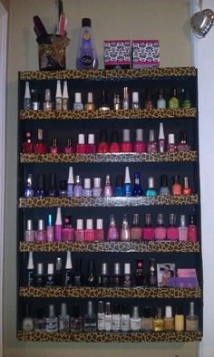 DiY Nail Polish Storage Rack. Foam board, glue gun, duck tape. I need to make one of these!
