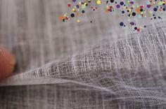 Silky non-woven textile