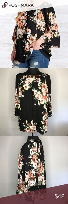 "Plus Size Floral Print Bell Sleeve Top Instantly feel breezy & beautiful in this blouse. With 3/4 length sleeves, this top features a floral woven print, bell sleeves & shirring at its neckline. Bust measurement laying flat: 1X - 26""; 2X - 27""; 3X - 28"" Full Length: 30 Fabric: Rayon Crepon Content: 100% Rayon Made In: USA mockingbird + poppy Tops Blouses"