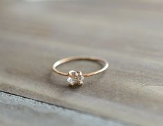 This simple yet gorgeous ring has a spectacular sparkle. A natural Herkimer quartz diamond sits encaged by a 14k gold fill ring with prongs. Herkimers vary between 4-5mm. Your ring will be similar to the one in the pictures due to the natural shapes of each herkimer used. Herkimer diamond quartz have an extreme clarity like that of real diamonds, but in fact these are double terminated quartz crystals. They are found in Herkimer Couny, New York.  *Available on 14k rose gold fill
