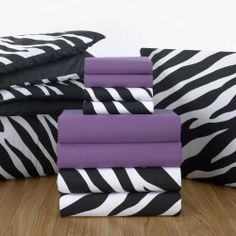 Grape sheets and Zebra comforter. Find this cute sheet set and patterned comforter in any Value Pak on ocm.com! #dorm #ourcampusmarket #bedding