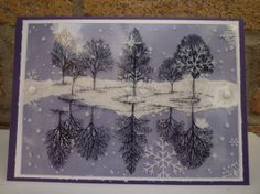 By Karen Wiechert. Mirror Technique with Acetate. Use black StazOn ink to stamp the trees onto acetate. Let dry completely. Turn the acetate 180º then flip it over right to left so the stamped trees are underneath the acetate & at the bottom of the sheet. Stamp the trees again in black StazOn at the top, making sure to place the trunks in line with the previously stamped trunks. Let dry. Add embellishments, panel(s), card base, etc.