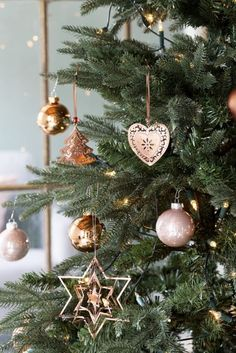 copper and rose gold ornaments for decorating a Christmas tree