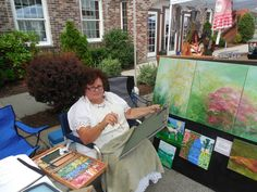 Artist Joan Kehlenbeck creating pastels at 16th Annual Arts Walk. Joan is the President of the River Valley Artists' Guild