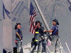 Two days after the massive terrorist attacks on the World Trade Center, only debris and an American flag could be seen standing at Ground Zero. This Sept. 2001 photo shows the destruction and devastation of the attacks. World Trade Center, Trade Centre, American History, American Flag, American Pride, American Presidents, Remembering September 11th, New York City, Heroes