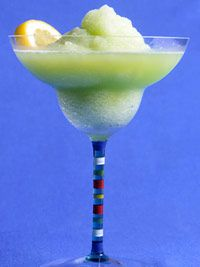 Frozen Lime Margarita  12 ounce can frozen limeade concentrate  2/3 cup tequila  1/2 cup light orange juice or orange liqueur  4 cups ice cubes  1/2 medium lime  Coarse salt  Orange slices