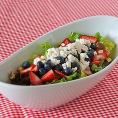 Red White and Blue Salad Ingredients 1 head romaine lettuce 1 head red lettuce 1 c. glazed walnuts or pecans 2 c. sliced strawberries 1 ½ c. blueberries 4 oz. crumbled feta cheese Dressing: 1 cup sugar ½ cup red wine vinegar 1 tsp dry mustard 1½ tsp salt ½ cup chopped red onion 1 cup canola oil 1 Tbsp poppy seeds