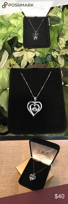 New Kay Jewelers Silver Heart ❤️Necklace New without tags!  Sterling Silver heart ❤️ necklace with motion stone. Not sure if it's cubic zirconia or similar type stone.  Catches the light and sparkles beautifully!  Comes in Kay's black box and gold gift box. Kay Jewelers Jewelry Necklaces