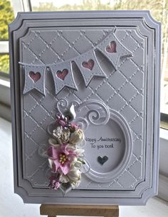 Hi everyone I have another card to share with you. On this card ... I have used Spellbinders grand large labels, , embossing folder is Sue WIlson heart lattice, SB classic oval, SB jewel & flou...