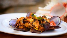 Mussels  Ulathiyathu - this delicate yet simple stir-fry emphasizes on browning the onions to ensure that the masala seeps  into the mussels.