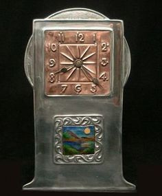 """LIBERTY & CO, """"Tudric Pewter, Copper and Enamel Clock"""", Height: 25cm, Stamped marks to base 'Tudric 0383', Circa: 1900."""