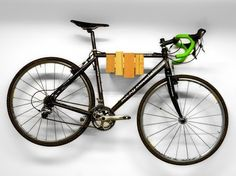 wall-mounted bike rack, wood