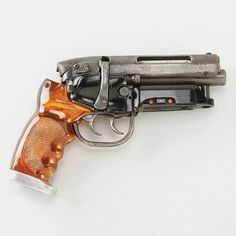 "Harrison Ford ""Rick Deckard"" hero blaster from Blade Runner Arguably one of the single most important weapons in Science Fiction history is the hero firing blaster used by Rick Deckard (Harrison Ford) to ""retire"" replicants in Ridley Scott's timeless Sci-Fi classic Blade Runner."