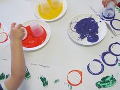The Very Hungry Caterpillar paintings using cups & paint (how the world works)
