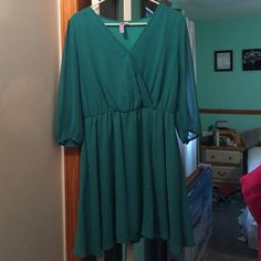 Francesca's Dress Green dress from Francesca's. There is a B-neck with a snap so you can control how revealing you'd like to be. Detailing down the front of the dress, there is a cinched waist. The sleeves are 3/4 length sleeves. Only worn once. Make me an offer  Francesca's Collections Dresses