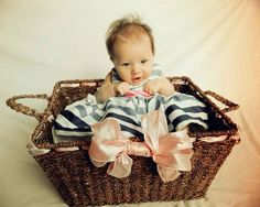 An old basket, some ribbon, and a sheet = awesome picture! And of course a cute baby!