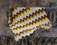 Granny squares are regaining popularity but I really didn't want to do more squares. A ripple seemed like it would be fun but still wasn't tickling my fancy. After some thought, I suddenly realized that a spike stitch would make a good alternative … so here we are.