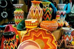 rural baskets (from africa, actually) but such lovely pops of color for a scandi-white room.