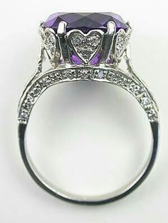 ring featuring heart design surrounding purple stone