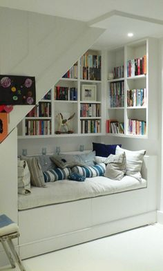 Under-Stair Bookshelves and Seating Area- awesome nook