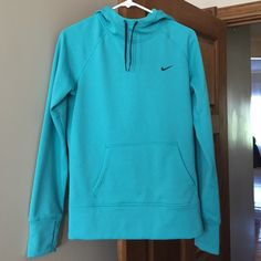 Women's Nike sweatshirt Teal Therma-fit sweatshirt. Women's size small. Never worn. New without tags. Thumb holes in the sleeves. Nike Jackets & Coats