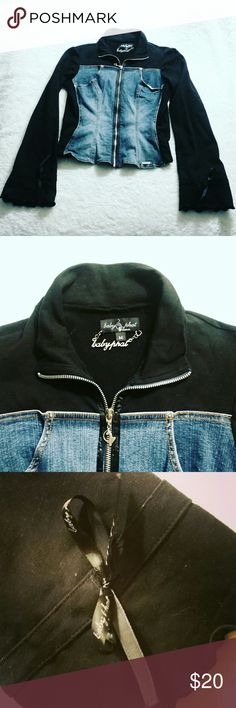 Baby Phat Black & Denim Stretch Jacket Baby Phat Black & Denim Stretch Jacket. This was my fav! This jacket is form fitting at looks awesome on. Zipper has the Baby Phat logo. Each sleeve is slightly flared with ribbons to tighten the sleeves.  Size: Medium Baby Phat Jackets & Coats Jean Jackets