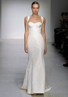 sleek wedding dress, i like the top of this dress, would prefer a different skirt.