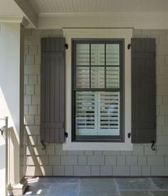 Brown window and shutter, cream? trim, taupe siding