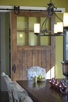 I love this trend of using old doors as upcycled sliding doors. Such a cool way to add some personality to a room.