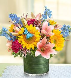 Welcome Spring with our colorful Simple Sophistication arrangement featuring a beautiful array of spring flowers such as sunflowers, lilies, dianthus and calcynia, complete with a playful spring butterfly pick!