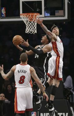 NBA players sport nicknames on jerseys  Brooklyn Nets' Paul Pierce (34) drives past Miami Heat's Chris Andersen (11) during the first half of an NBA basketball game on Friday, Jan. 10, 2014, in New York